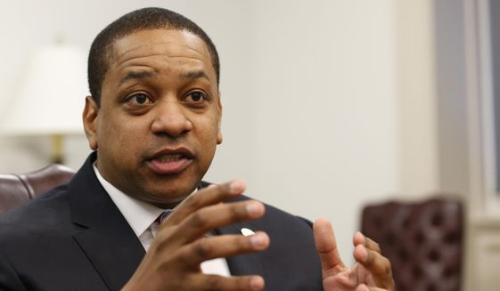 Virginia Lt. Gov. Justin Fairfax speaks during an interview in his office at the Capitol in Richmond, Va., on Saturday, Feb. 2, 2019. Fairfax answered questions about the controversial photo in Gov. Ralph Northam's yearbook page. (AP Photo/Steve Helber)