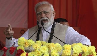 Indian Prime Minister Narendra Modi addresses a public meeting in Thakurnagar, in the eastern Indian state of West Bengal, Saturday, Feb. 2, 2019. Modi has praised a controversial citizenship bill pending in Parliament at a rally in West Bengal state, kick-starting his Hindu nationalist party's campaign to retain power in general elections due by May. (AP Photo/Bikas Das)