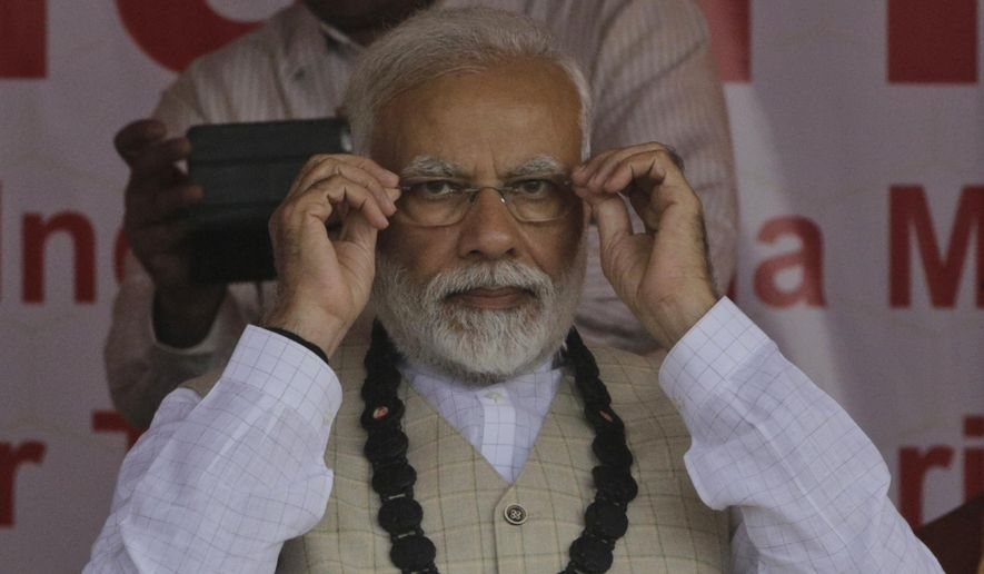 Months before he faces a re-election vote, Indian Prime Minister Narendra Modi has issued a decree allowing police, tax officials and other government agencies to monitor personal electronic devices without a court order. (Associated Press/File)