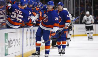 New York Islanders left wing Michael Dal Colle (28) celebrates with teammates after scoring a goal against the Los Angeles Kings in the third period of an NHL hockey game Saturday, Feb. 2, 2019, in Uniondale, N.Y. The Islanders won 4-2. (AP Photo/Adam Hunger)