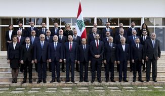 In this photo released by the Lebanese Government, members of Lebanon's new government, pose for an official picture at the Presidential Palace in Baabda, east of Beirut, Lebanon, Saturday, Feb. 2, 2019. The new Cabinet was announced Thursday night breaking a nine-month deadlock that had deepened Lebanon's economic woes. (Dalati Nohra/Lebanese Government via AP)