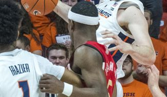 Illinois forward Giorgi Bezhanishvili (15) looks to pass out a offensive rebound to Illinois guard Trent Frazier (1) who is being guarded by Nebraska guard Glynn Watson Jr. (5) during an NCAA college basketball game in Champaign, Ill., Saturday. Feb. 2, 2019. (AP Photo/Robin Scholz)