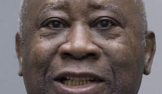 FILE - In this Jan. 15, 2019, file photo, former Ivory Coast President Laurent Gbagbo enters the courtroom of the International Criminal Court in The Hague, the Netherlands, where judges acquitted Gbagbo and ex-government minister Charles Ble Goude of crimes committed during the 2010 election for lack of evidence. A defense lawyer for former Ivory Coast president Laurent Gbagbo said Friday that he should be immediately and unconditionally released from International Criminal Court detention, more than two weeks after his acquittal on charges of involvement in deadly post-election violence.(AP Photo/Peter Dejong, Pool, File)