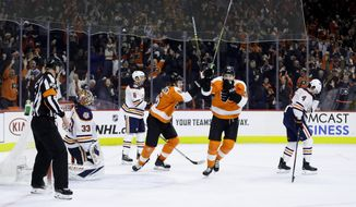 Philadelphia Flyers' James van Riemsdyk (25) and Travis Sanheim (6) celebrate past Edmonton Oilers' Kris Russell (4), Ty Rattie (8) and Cam Talbot (33) after Nolan Patrick scored the game-winning goal during overtime in an NHL hockey game, Saturday, Feb. 2, 2019, in Philadelphia. Philadelphia won 5-4.(AP Photo/Matt Slocum)