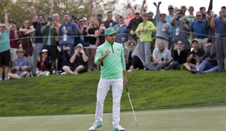 Rickie Fowler waves after making a birdie putt on the fifth green during the third round of the Phoenix Open PGA golf tournament, Saturday, Feb. 2, 2019, in Scottsdale, Ariz. (AP Photo/Matt York)