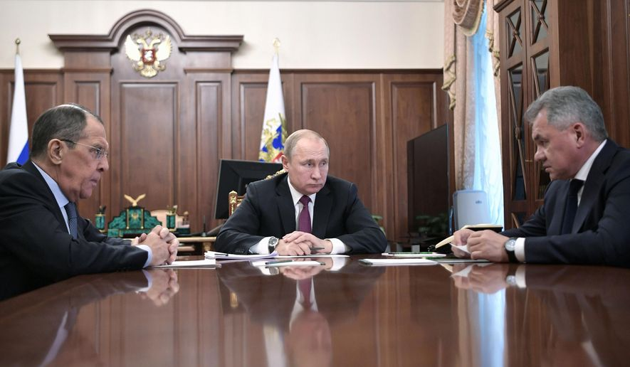 Russian President Vladimir Putin, cente, attends a meeting with Russian Foreign Minister Sergey Lavrov, and Defense Minister Sergei Shoigu in the Kremlin in Moscow, Russia, Saturday, Feb. 2, 2019. Putin said that Russia will abandon the 1987 Intermediate-Range Nuclear Forces treaty, following in the footsteps of the United States, but noted that Moscow will only deploy intermediate-range nuclear missiles if Washington does so. (Alexei Nikolsky, Sputnik, Kremlin Pool Photo via AP)