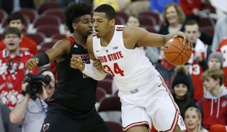 Ohio State forward Kaleb Wesson, right, drives against Rutgers forward Myles Johnson during the first half of an NCAA college basketball game in Columbus, Ohio, Saturday, Feb. 2, 2019. (AP Photo/Paul Vernon)