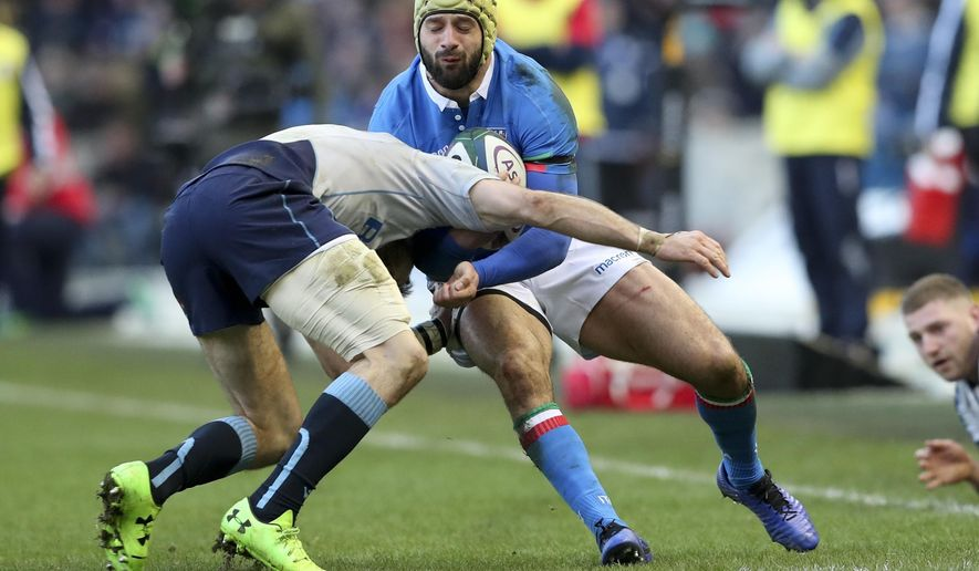 Scotland's Tommy Seymour, left, tackles Italy's Angelo Esposito during the Six Nations rugby union international between Scotland and Italy, at the Murrayfield Stadium in Edinburgh, Scotland, Saturday, Feb. 2, 2019. (AP Photo/Scott Heppell)