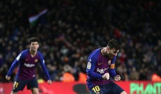 FC Barcelona's Lionel Messi celebrates after scoring during the Spanish La Liga soccer match between FC Barcelona and Valencia at the Camp Nou stadium in Barcelona, Spain, Saturday, Feb. 2, 2019. (AP Photo/Manu Fernandez)