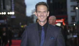 """FILE - In this Sept. 26, 2016 file photo, actor and director Peter Berg poses for photographers upon arrival at the premiere of the film """"Deepwater Horizon"""" in London. Berg directed a new Super Bowl commercial called """"The 100-Year Game"""" that paid homage to past and present NFL players including Tom Brady, Jim Brown, Joe Montana, Dick Butkus, Deion Sanders and Patrick Mahomes. The 2-minute ad will air during Super Bowl 53 on Sunday, Feb. 3, 2019. (Photo by Joel Ryan/Invision/AP, File)"""