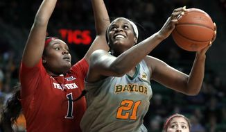 Texas Tech center Erin DeGrate (1) defends as Baylor center Kalani Brown (21) positions for a shot in the second half of an NCAA college basketball game in Waco, Texas, Saturday, Feb. 2, 2019. (AP Photo/Tony Gutierrez)