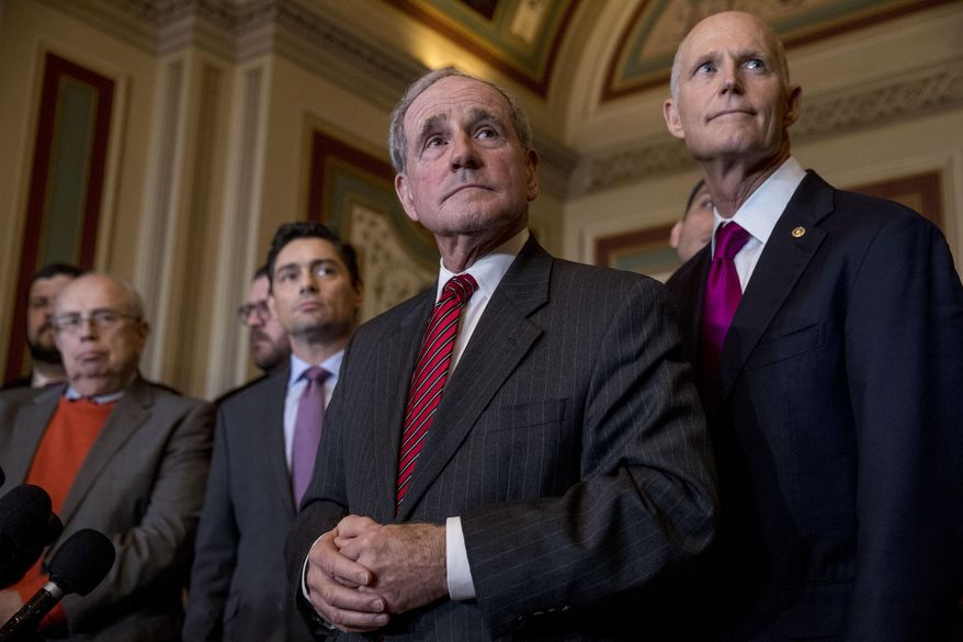 """In this Jan. 30, 2019, photo, from left, OAS Special Representative Gustavo Tarre Briceno, Venezuelan opposition's new envoy in Washington Carlos Vecchio, Chairman Sen. James Risch, R-Idaho, and Sen. Rick Scott, R-Fla., listen to a question from a reporter at a news conference following a Senate Foreign Relations Committee meeting on Capitol Hill in Washington. Two years into President Donald Trump's administration, the president's allies in Congress are quietly trying to influence and even reshape his """"America First"""" foreign policy agenda. (AP Photo/Andrew Harnik)"""