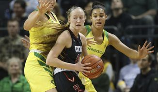Oregon's Erin Boley, left, and Satou Sabally, right, pressure Utah's Dru Gylten during the first quarter of an NCAA college basketball game Friday, Feb. 1, 2019, in Eugene, Ore. (AP Photo/Chris Pietsch)