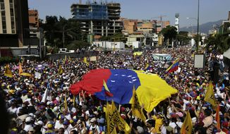 Anti-government protesters gather for the start of a nationwide demonstration demanding the resignation of President Nicolas Maduro, in Caracas, Venezuela, Saturday, Feb. 2, 2019. Momentum is growing for Venezuela's opposition movement led by lawmaker Juan Guaido, who has called supporters back into the streets for nationwide protests Saturday, escalating pressure on embattled Maduro to step down. (AP Photo/Fernando Llano)