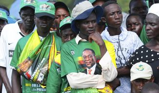A subdued crowd wait for Zimbabwean President Emmerson Mnangagwa at a rally in Mount Darwin about 200 Kilometres north of Harare, Saturday, Feb, 2, 2019. A spokesman says Zimbabwe's president has skipped his first political rally since last month's deadly military crackdown on protests so he could explain the unrest to fellow African leaders. President Emmerson Mnangagwa's administration has been under pressure amid reports of at least 12 people killed, hundreds wounded and some women raped.  (AP Photo/Tsvangirayi Mukwazhi)