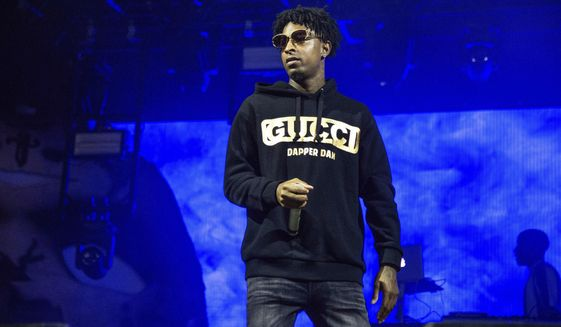 FILE - In this Sunday, Oct. 28, 2018, file photo, 21 Savage performs at the Voodoo Music Experience in City Park in New Orleans. Authorities in Atlanta say Grammy-nominated rapper 21 Savage is in federal immigration custody. U.S. Immigration and Customs Enforcement spokesman Bryan Cox says the artist, whose given name is Sha Yaa Bin Abraham-Joseph, was arrested in a targeted operation early Sunday, Feb. 3, 2019, in the Atlanta area. (Photo by Amy Harris/Invision/AP, File)