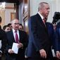 Turkish President Recep Tayyip Erdogan (right) and Russian President Vladimir Putin (center) held talks last month in Moscow. Russia and Turkey are jockeying for clout as the U.S. plans to withdraw its troops from Syria after battling the Islamic State. (Associated Press/File)