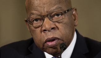 FILE - In this Jan. 11, 2017, file photo, Rep. John Lewis, D-Ga. testifies on Capitol Hill in Washington. Dante Antoine Rosser accused of threatening the staff of Lewis is set to appear in court Monday, March 6, 2017, in Atlanta for a hearing to decide whether he'll continue to be held in custody. (AP Photo/Cliff Owen, File)