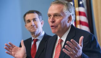 Virginia Gov. Terry McAuliffe, right, gestures as he and Gov.-elect, Lt. gov Ralph Northam, detail their legislative package at the Capitol in Richmond, Va., Tuesday, Jan. 9, 2018. Northam will be sworn in on Saturday. (AP Photo/Steve Helber)