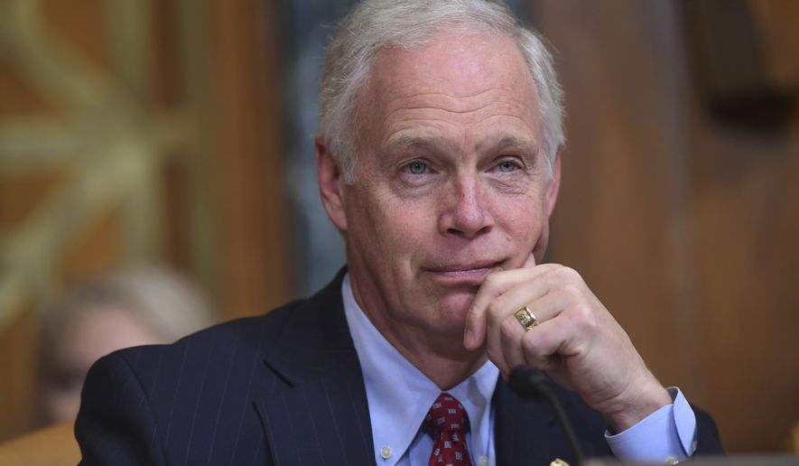 Sen. Ron Johnson, R-Wis., listens as Budget Director Mick Mulvaney testifies before the Senate Budget Committee on Capitol Hill in Washington, Tuesday, Feb. 13, 2018, on President Donald Trump's fiscal year 2019 budget proposal. (AP Photo/Susan Walsh)
