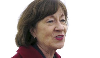 Sen. Susan Collins speaks to the media outside Bath Iron works, where she spoke during a ceremony marking construction of a new warship, Friday, Nov. 9, 2018, in Brunswick, Maine. (AP Photo/David Sharp)