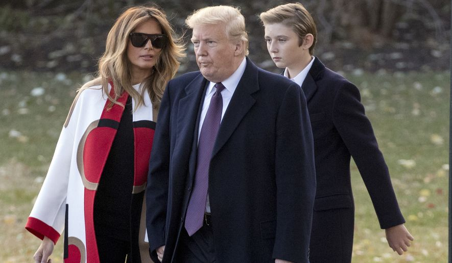 President Donald Trump accompanied by first lady Melania Trump, and their son Barron, right, walks towards Marine One on the South Lawn of the White House in Washington, Tuesday, Nov. 20, 2018, for a short trip to Andrews Air Force Base, Md., and then on to Palm Beach Fla., and Mar-a-Lago for Thanksgiving (AP Photo/Andrew Harnik)