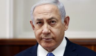 Israeli Prime Minister Benjamin Netanyahu attends the weekly cabinet meeting in Jerusalem Sunday, Feb. 3, 2019. (Ronen Zvulun/Pool Photo via AP)