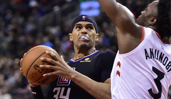 Los Angeles Clippers forward Tobias Harris (34) drives against Toronto Raptors forward OG Anunoby (3) during second-half NBA basketball game action in Toronto, Sunday, Feb. 3, 2019. (Frank Gunn/The Canadian Press via AP)