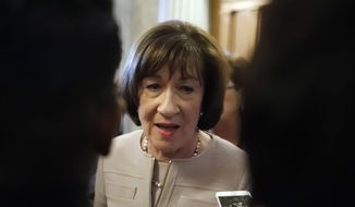 FILE- In this Oct. 5, 2018, file photo Sen. Susan Collins, R-Maine, talks with reporters after speaking on the Senate floor, on Capitol Hill in Washington. Records show that Collins had the best fundraising quarter of her career after she delivered a pivotal vote that helped seat Brett Kavanaugh on the U.S. Supreme Court. (AP Photo/Alex Brandon, File)