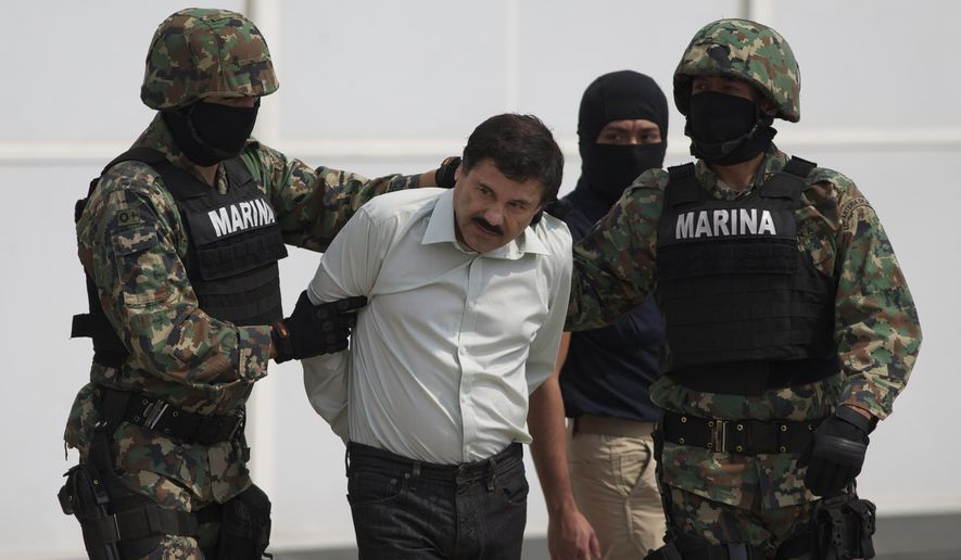 """FILE - In this Saturday, Feb. 22, 2014 file photo, Joaquin """"El Chapo"""" Guzman, center, is escorted to a helicopter in handcuffs by Mexican navy marines at a hanger in Mexico City, after he was captured overnight in the beach resort town of Mazatlan. The New York trial of Guzman is drawing to a close, but the question of controlling the corruption that allowed the Sinaloa cartel to flourish in Mexico will live on even after jurors reach a verdict. DEA agent Victor Vazquez told jurors he would only work with the Mexican marines when trying to capture Guzman and other leaders of the Sinaloa cartel, because that wing of the armed forced were viewed as less susceptible to corruption. (AP Photo/Eduardo Verdugo, File)"""