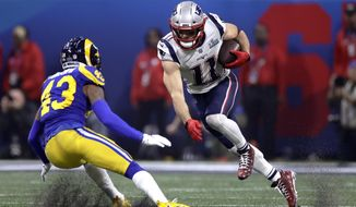 New England Patriots' Julian Edelman, right, tries to elude Los Angeles Rams' John Johnson III (43) after catching a pass during the second half of the NFL Super Bowl 53 football game Sunday, Feb. 3, 2019, in Atlanta. (AP Photo/Carolyn Kaster)