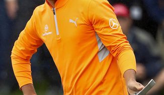 Rickie Fowler reacts to his missed birdie putt on the fourth green during the final round of the Phoenix Open PGA golf tournament, Sunday, Feb. 3, 2019, in Scottsdale, Ariz. (AP Photo/Matt York)