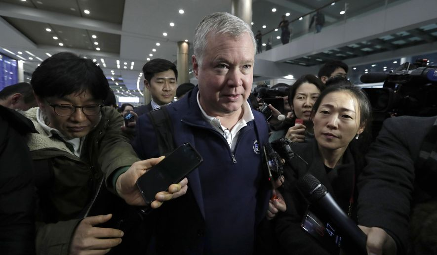 U.S. Special Representative for North Korea Stephen Biegun, center, is questioned by reporters upon his arrival at Incheon International Airport in Incheon, South Korea, Sunday, Feb. 3, 2019. Biegun will meet with South Korea's Special Representative for Korean Peninsula Peace and Security Affairs Lee Do-hoon. (AP Photo/Lee Jin-man)
