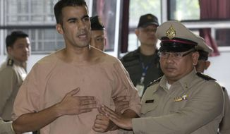 Detained Bahraini soccer player Hakeem al-Araibi, front left, arrives at the criminal court in Bangkok, Thailand Monday, Feb. 4, 2019. Al-Araibi has said he fled his home country due to political repression and human rights groups and activists fear he risks torture if he is sent back. Bahrain wants him returned to serve a 10-year prison sentence he received in absentia in 2014 for vandalizing a police station, which he denies. (AP Photo/Sakchai Lalit)