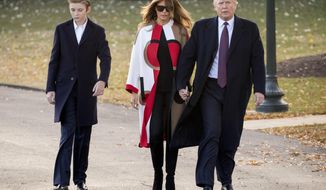 "FILE- In this Nov. 20, 2018, file photo President Donald Trump accompanied by first lady Melania Trump, and their son Barron, left, walks towards Marine One on the South Lawn of the White House in Washington. Trump says he wouldn't steer son Barron toward football, saying it's ""a dangerous sport,"" but also wouldn't stand in the way if the soccer-playing 12-year-old wanted to put on pads. The NFL fan tells CBS' ""Face the Nation"" in an interview taped before the Super Bowl that football is ""really tough."" (AP Photo/Andrew Harnik, File)"