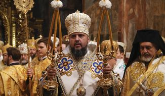 Metropolitan Epiphanius, newly elected head of the Orthodox Church of Ukraine, Metropolitan of Kyiv and All Ukraine, conducts a service during his enthronement in the St. Sophia Cathedral in Kiev, Ukraine, Sunday, Feb. 3, 2019. Epiphanius has been elected to head the new Ukrainian church independent from the Russian Orthodox Church. (AP Photo/Efrem Lukatsky)