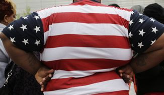 This May 8, 2014, file photo shows an overweight man in New York. (AP Photo/Mark Lennihan, File)