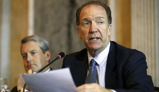 David Malpass, Under Secretary for International Affairs at the Treasury Dept., right, speaks about Brexit, next to Randal Quarrels, Vice Chairman for Supervision, Board of Governors of the Federal Reserve, during a meeting of the Financial Stability Oversight Council, Tuesday, Oct. 16, 2018, at the Treasury Department, in Washington. (AP Photo/Jacquelyn Martin)