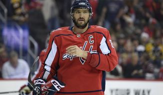 Washington Capitals left wing Alex Ovechkin (8), of Russia, stands on the ice during the first period of an NHL hockey game against the Boston Bruins, Sunday, Feb. 3, 2019, in Washington. (AP Photo/Nick Wass) ** FILE **