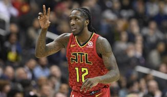 Atlanta Hawks forward Taurean Prince (12) gestures after he made a basket during the second half of an NBA basketball game against the Washington Wizards, Monday, Feb. 4, 2019, in Washington. The Hawks won 137-129. (AP Photo/Nick Wass)