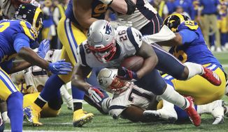 In this Sunday, Feb. 3, 2019, photo New England Patriots' Sony Michel (26) dives over the goal line for a touchdown during the second half of the NFL Super Bowl 53 football game in Atlanta. (Curtis Compton/Atlanta Journal-Constitution via AP) ** FILE **