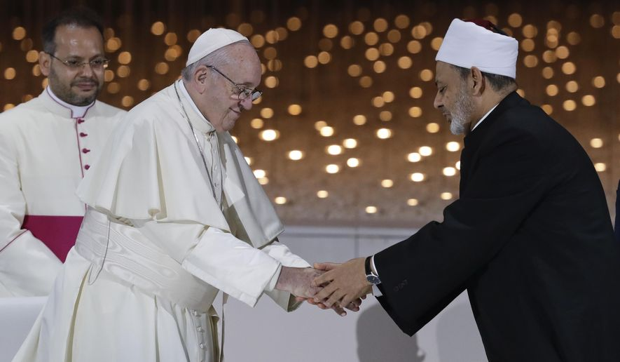 Pope Francis greets Sheikh Ahmed el-Tayeb, the grand imam of Egypt's Al-Azhar, after an Interreligious meeting at the Founder's Memorial in Abu Dhabi, United Arab Emirates, Monday, Feb. 4, 2019. Pope Francis has asserted in the first-ever papal visit to the Arabian Peninsula that religious leaders have a duty to reject all war and commit themselves to dialogue. (AP Photo/Andrew Medichini)