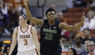 Baylor guard Moon Ursin (12) celebrates a score against Texas during the first half of an NCAA college basketball game, Monday, Feb. 4, 2019, in Austin, Texas. (AP Photo/Eric Gay)