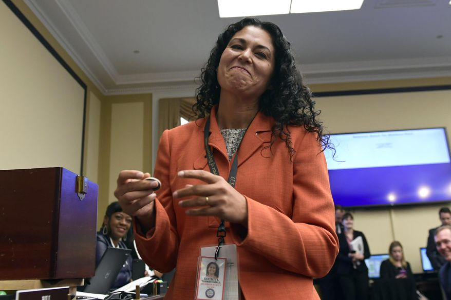 In this Nov. 30, 2018, file photo, Rep.-elect Xochitl Torres Small, D-N.M., reacts after drawing her number during the member-elect room lottery draw on Capitol Hill in Washington. Torres Small told The Associated Press she doesn't mind not getting as much attention as other freshmen in Congress because she has other goals around border security. (AP Photo/Susan Walsh, file)