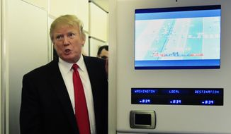 """In this Sunday, Feb. 3, 2019, photo, President Donald Trump speaks to reporters onboard Air Force One, on his way back to the White House in Washington from a weekend at his Mar-a-Lago estate in Palm Beach, Fla. Iraq's President Barham Salih spoke Monday at a forum in Baghdad slamming comments by Trump in which he said he wants to keep U.S. troops in Iraq """"to watch Iran."""" Salih said the U.S. president did not ask Iraq's permission for American troops stationed there to watch Iran. He said the Iraqi constitution forbids the use of Iraq as a base to threaten the interests or security of neighboring countries. (AP Photo/Manuel Balce Ceneta) **FILE**"""