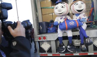 New York Mets mascots Mr. and Mrs. Met pose for pictures with the team's equipment before it is sent to spring training at Citi Field in New York, Monday, Feb. 4, 2019. (AP Photo/Seth Wenig)