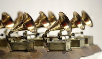 """FILE - In this Oct. 10, 2017, file photo, various Grammy Awards are displayed at the Grammy Museum Experience at Prudential Center in Newark, N.J. When the Grammys added more nominees to its top four categories, the Recording Academy said in a statement last year that the expansion from five to eight nominees would add more """"flexibility"""" for voters. But for those artists competing in the night's biggest awards, the change made it a little harder for any one nominee to win, statistically speaking. (AP Photo/Julio Cortez, File)"""
