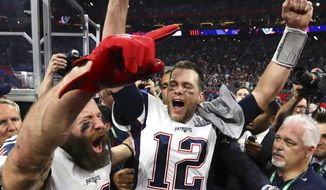 In this Sunday, Feb. 3, 2019, photo New England Patriots' Julian Edelman, left, and Tom Brady (12) celebrate after the NFL Super Bowl 53 football game against the Los Angeles Rams in Atlanta. The Patriots won 13-3. Edelman was named the Most Valuable Player. (Curtis Compton/Atlanta Journal-Constitution via AP) ** FILE **