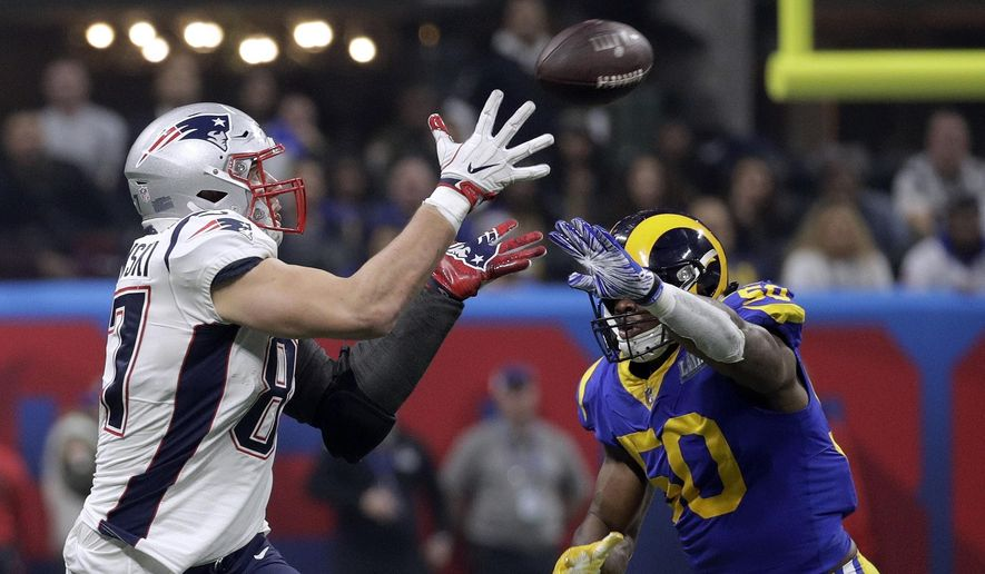d2612ca9b New England Patriots  Rob Gronkowski (87) catches a pass in front of Los  Angeles Rams  Cory Littleton (58) during the second half of the NFL Super  Bowl 53 ...