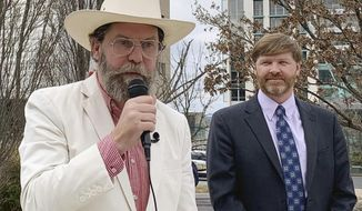 Proud Boys founder Gavin McInnes, left, discusses a lawsuit he filed against the Southern Poverty Law Center during a news conference in Montgomery, Ala., on Monday, Feb. 4, 2019. His attorney, Baron Coleman, listens on the right. McInnes contends the nonprofit organization wrongly labeled the far-right Proud Boys a hate group. (AP Photo/Kim Chandler)